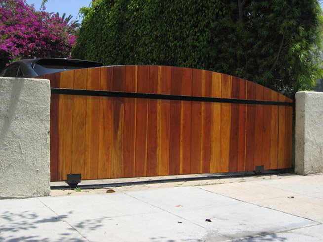 Is it plumb and level? Does it swing freely on its hinges? Can it move without dragging on the ground? Are the gate posts strong enough and secured in the ground with concrete to minimize flex or twist? Does the gate have a horizontal cross member to provide stability?