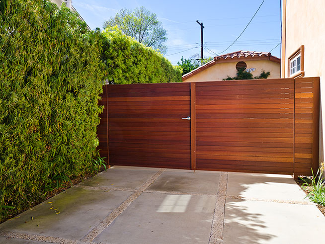 SLIDING GATE Openers  Sliding gates offer a number of advantages over swing gates. A sliding gate requires less space, which allows the full length of the driveway to be usable for parking vehicles. It also offers higher security due to the stronger resistance to being pushed open than swing gates. Sliding gates will also work on an upward sloping driveway where a pair of swing gates would not be able to open inward.